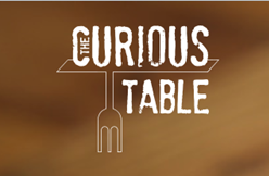 The Curious Table Logo